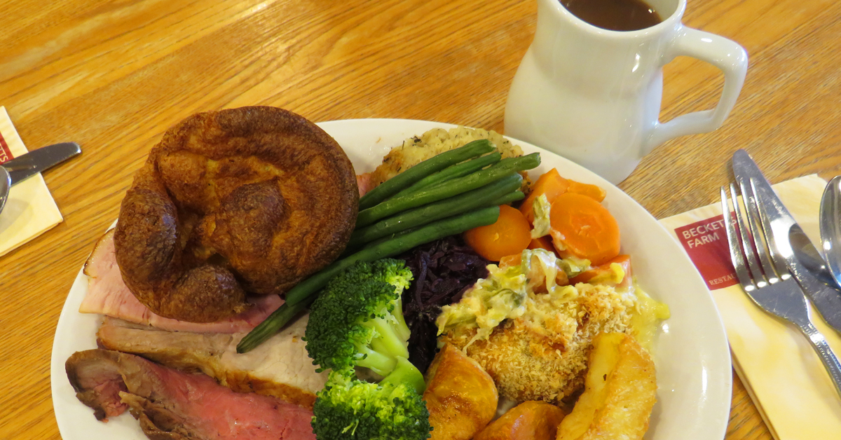 carvery dinner plated with gravy