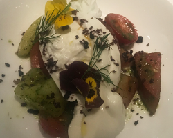 burrata with tomatoes and edible flowers