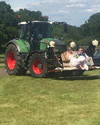 tractor carrying bride and groom