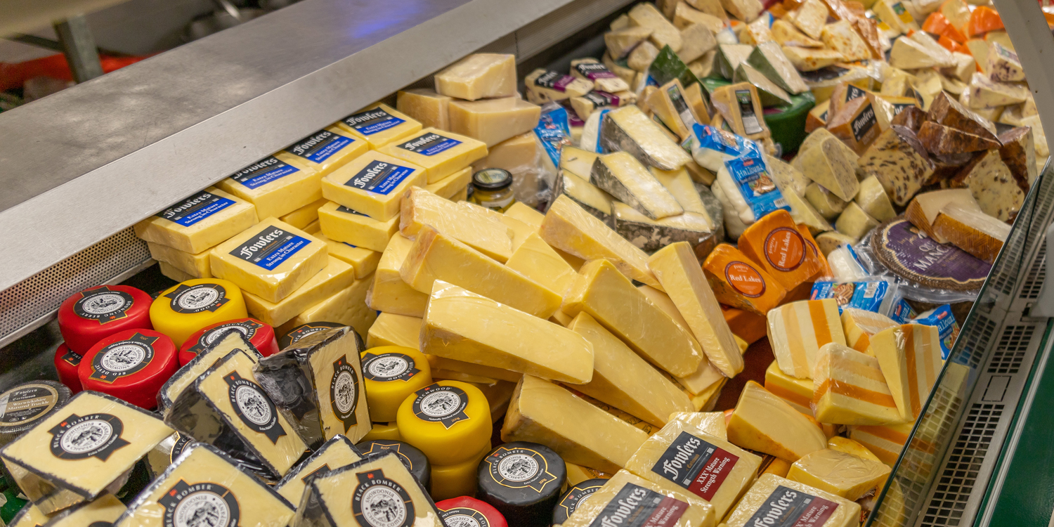 cheeses on deli counter