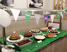 cakes on table on green cloth for macmillan cancer support